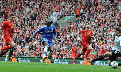 Demba Ba scores for Chelsea after a mistake by Liverpool's Steven Gerrard, left