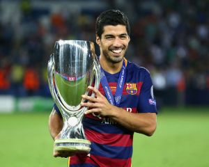 TBILISI, GEORGIA - AUGUST 11:  Luis Suarez of Barcelona celebrates with the UEFA Super Cup after the UEFA Super Cup between Barcelona and Sevilla FC at Dinamo Arena on August 11, 2015 in Tbilisi, Georgia.  (Photo by Chris Brunskill/Getty Images)